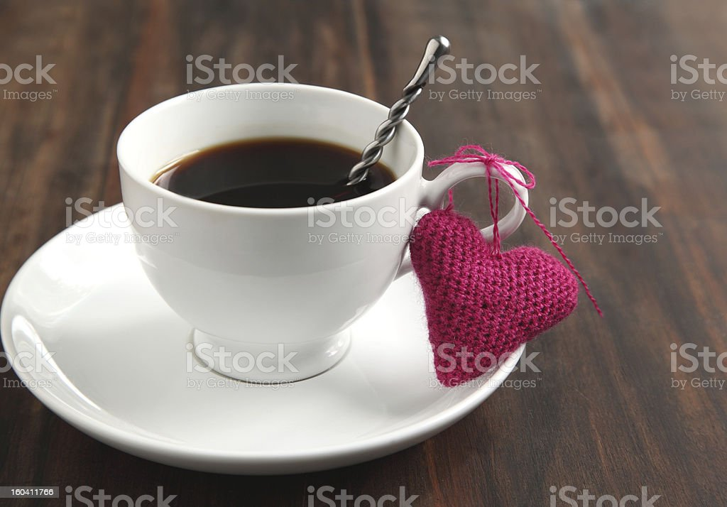 Cup of coffee with knitted heart royalty-free stock photo