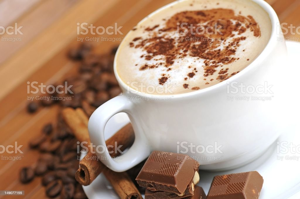 Cup of coffee with milk stock photo