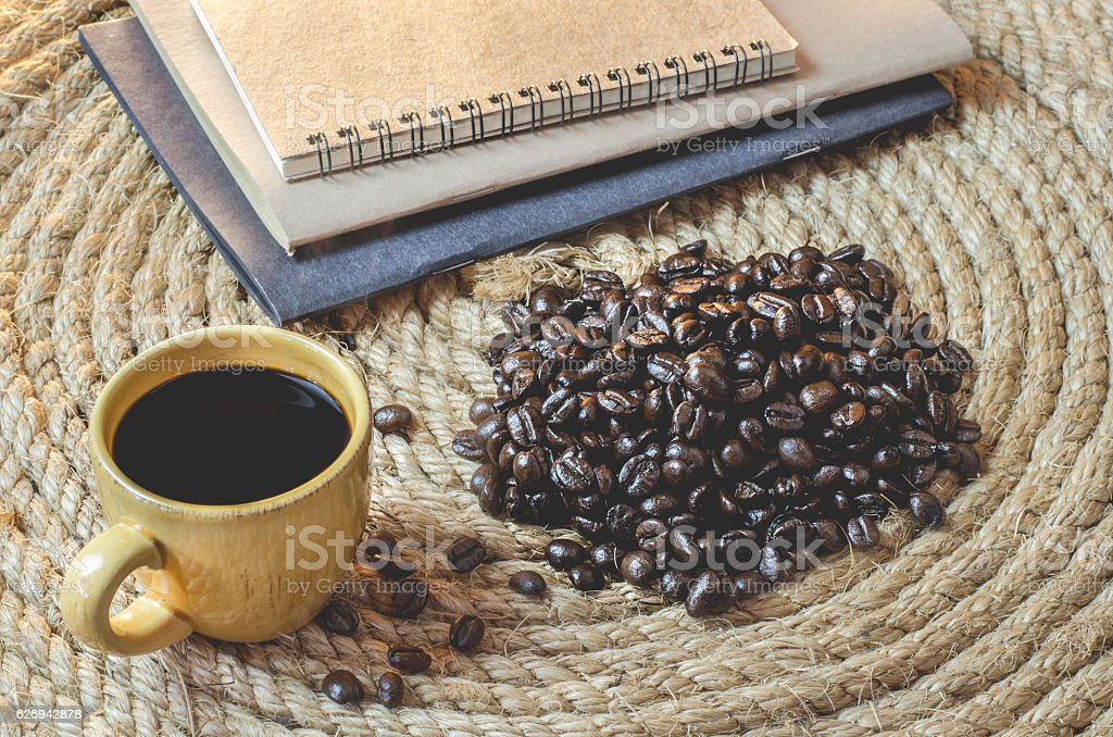 Cup of coffee with  notebook on a jute rope. stock photo