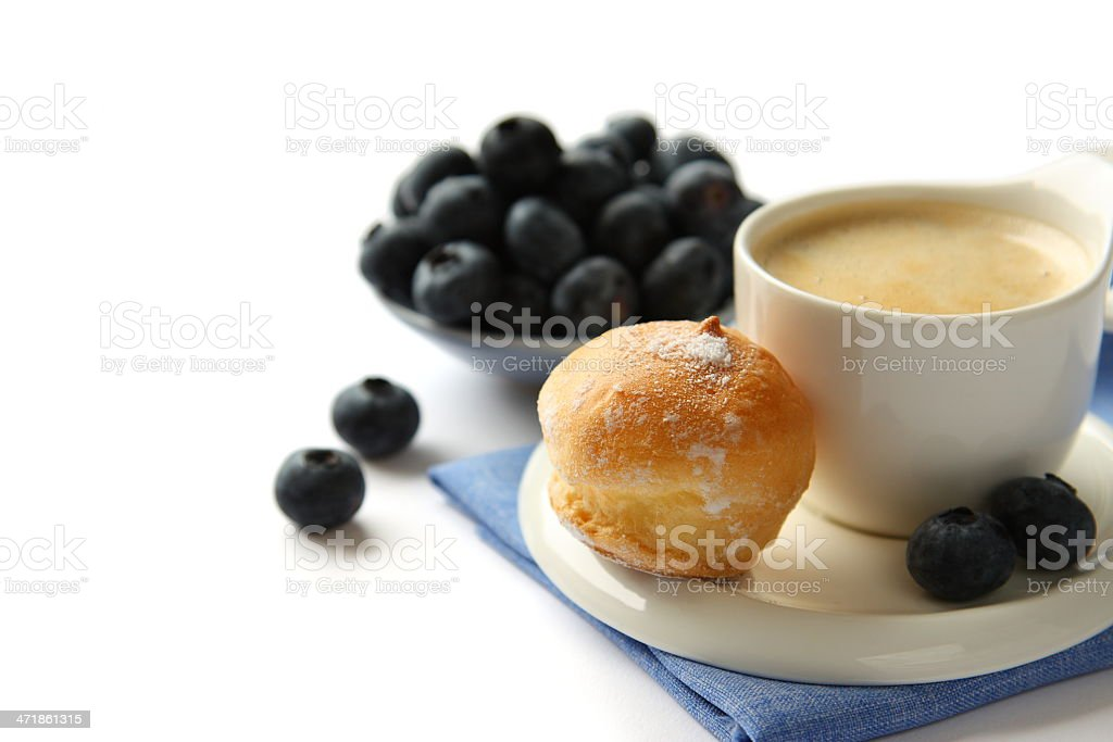 Cup of coffee with profiteroles and blueberries royalty-free stock photo