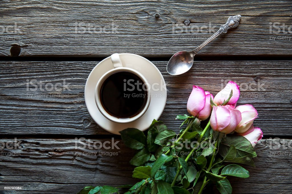 cup of coffee with red rose and copy space on wood background stock photo