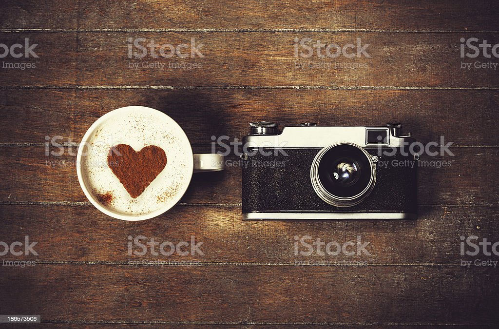 Cup of coffee with retro camera stock photo