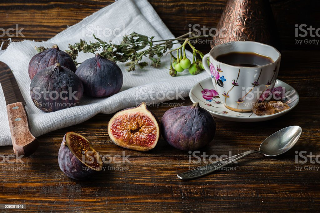 Cup of coffee with ripe figs for dessert stock photo