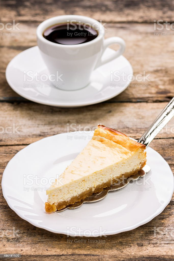 cup of coffee with slice of cheesecake stock photo