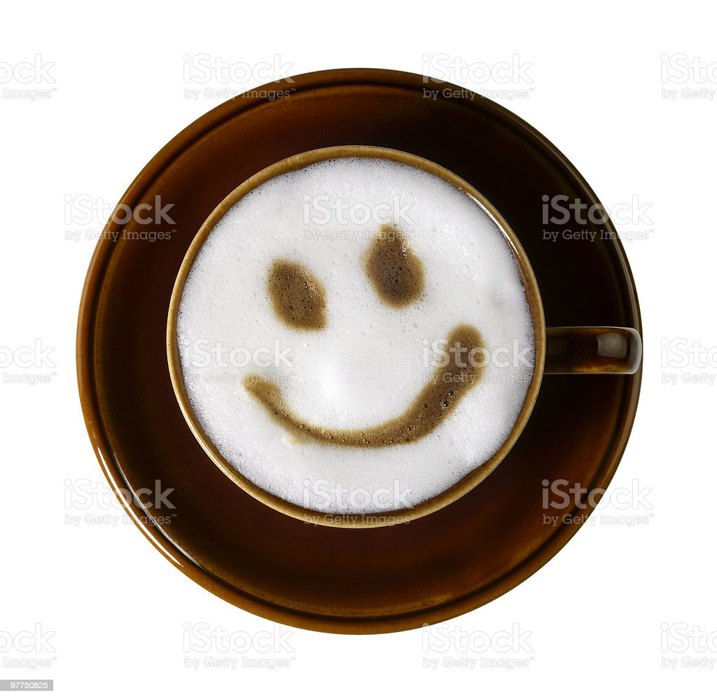 cup of coffee with smiley on milk froth stock photo