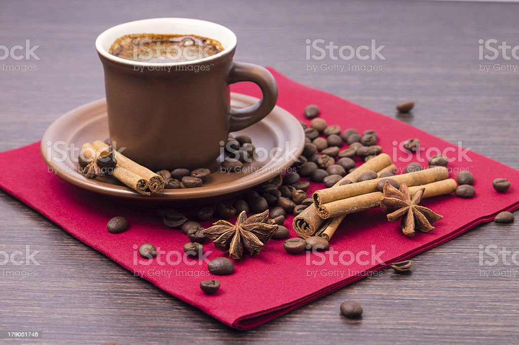 Cup of Coffee with Spices on Red Napkin royalty-free stock photo