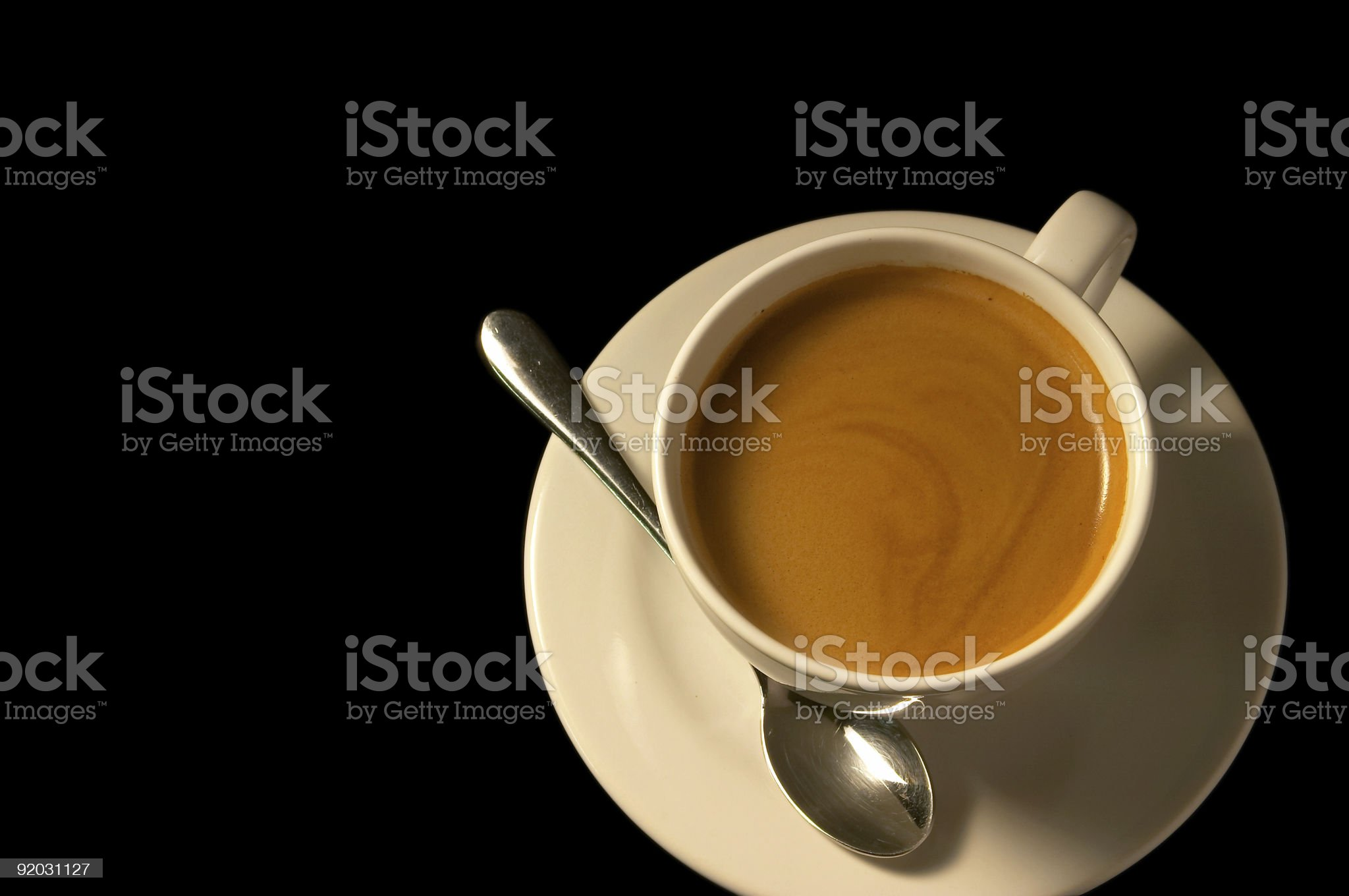 Cup of coffee with spoon royalty-free stock photo