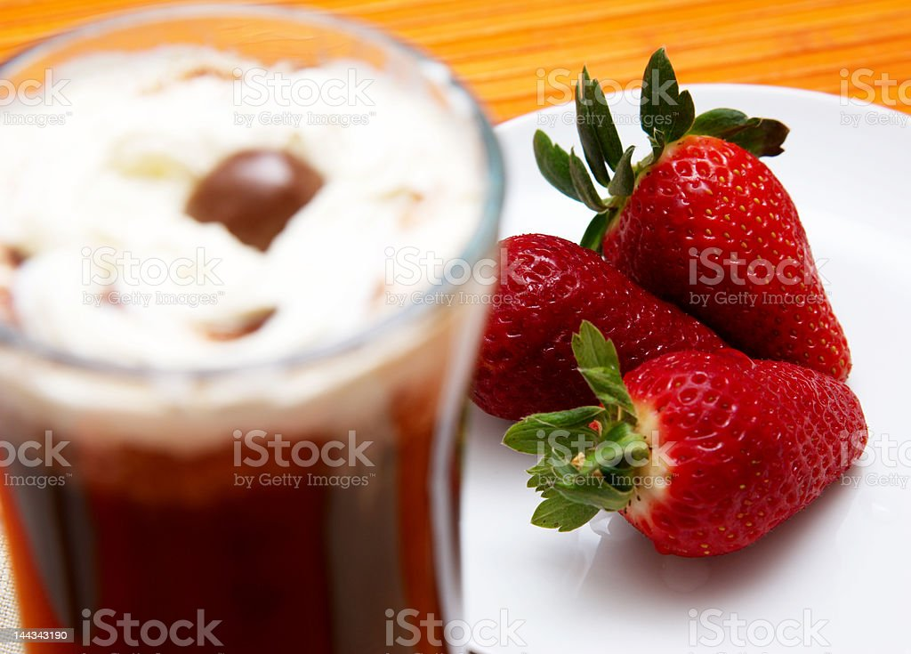 Cup of coffee with strawberries royalty-free stock photo