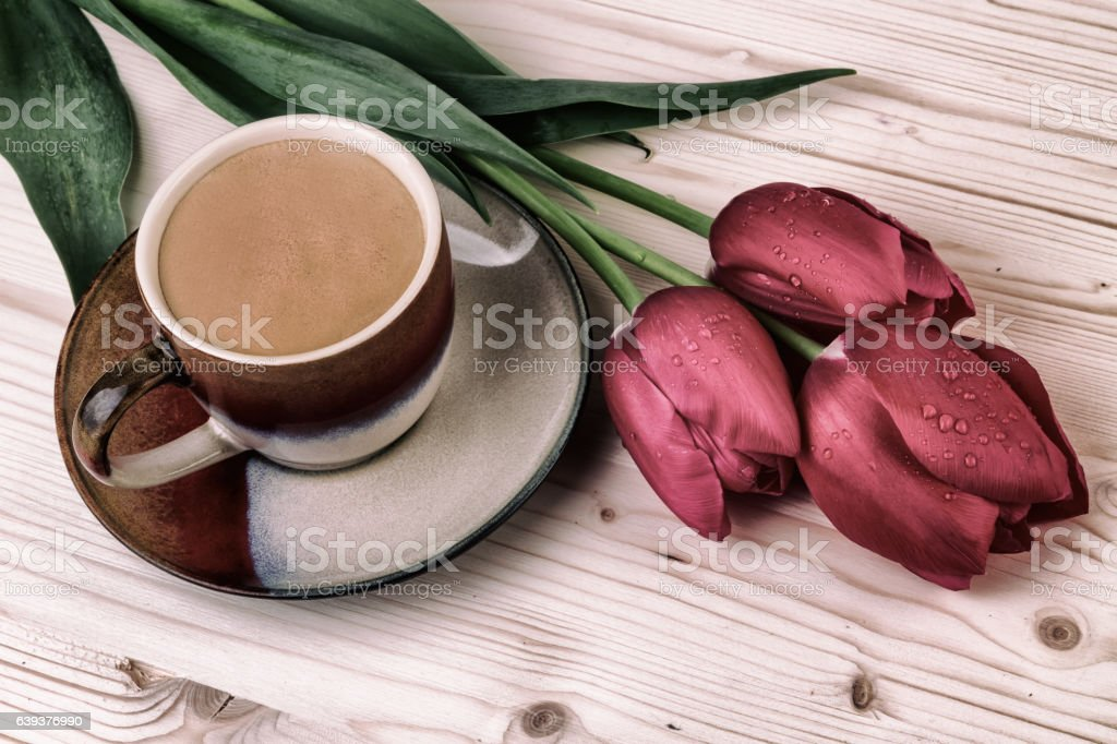 Cup of coffee with tulips.Vintage still life stock photo