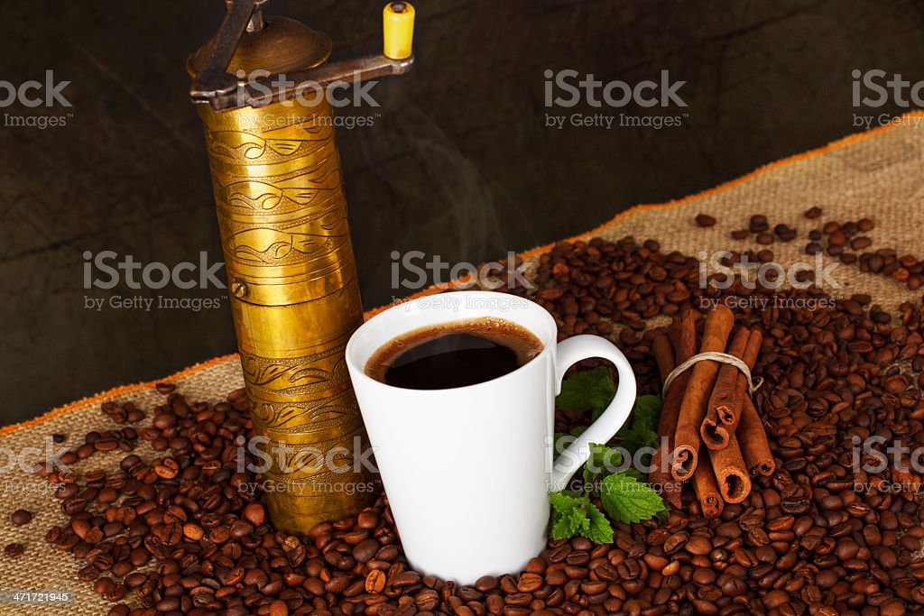 Cup of cooffee with Old-fashioned grinder royalty-free stock photo