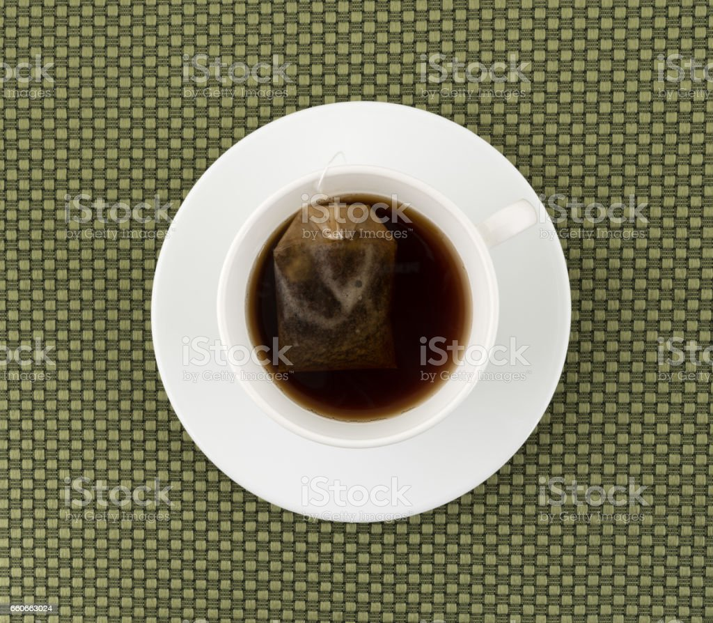 Cup of decaffeinated black tea with tea bag stock photo