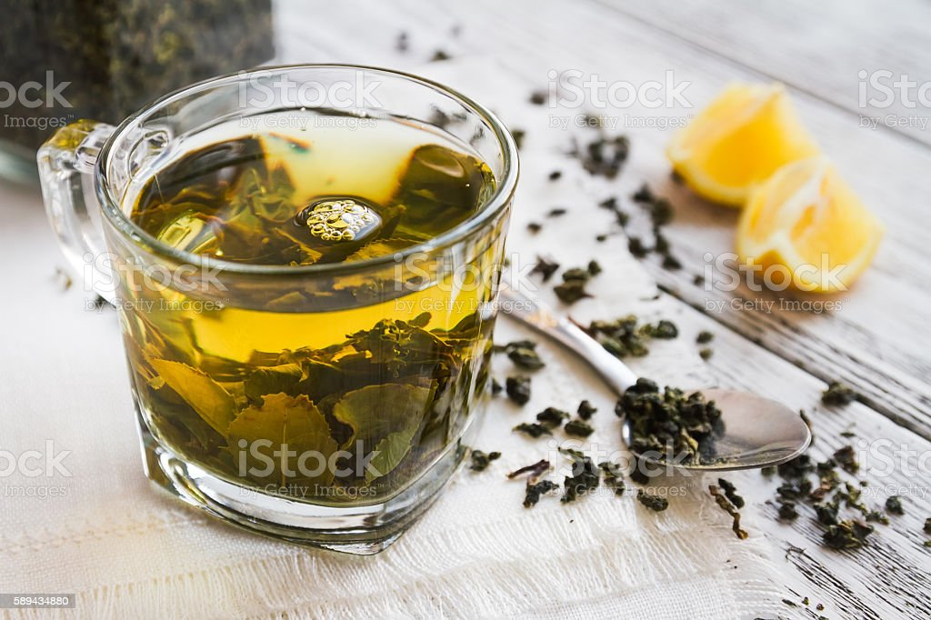 Cup of dreen tea with lemon on a table stock photo