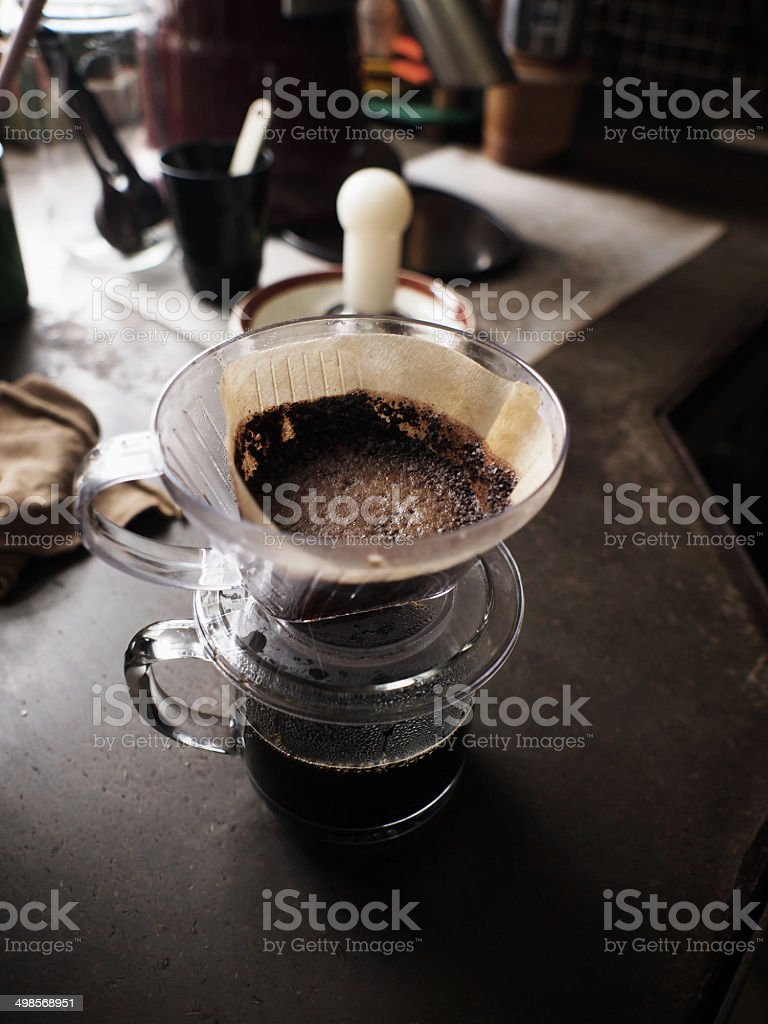 Cup of Dripping coffee on table stock photo