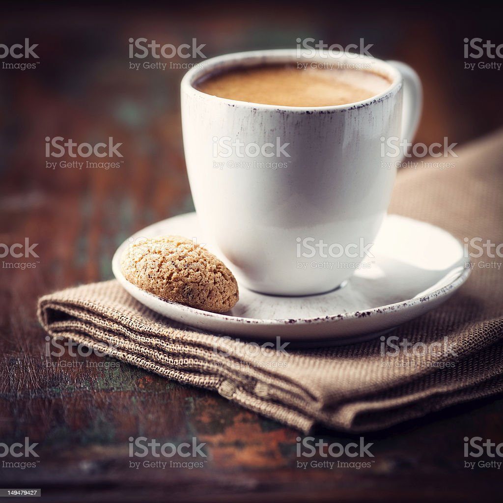 Cup of espresso and biscotti stock photo