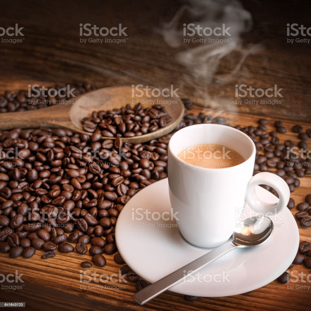 Cup of espresso coffee and beans stock photo