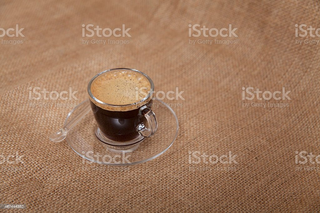 Cup of Espresso on a Wicker Cloth Surface stock photo