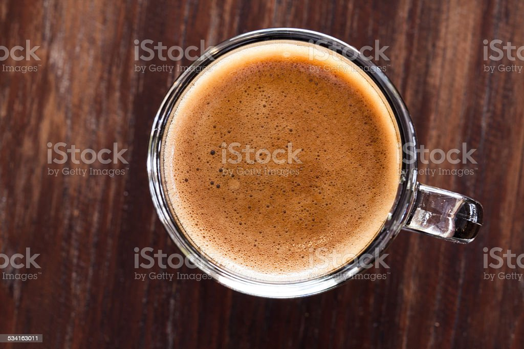 cup of espresso on a wooden background table. stock photo