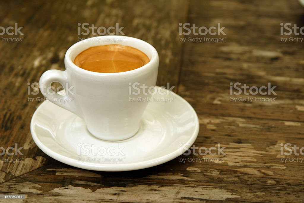 A cup of espresso sitting a white saucer royalty-free stock photo