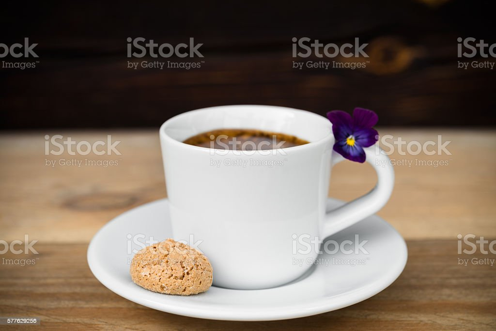 Cup of espresso with biscotti on wooden table stock photo