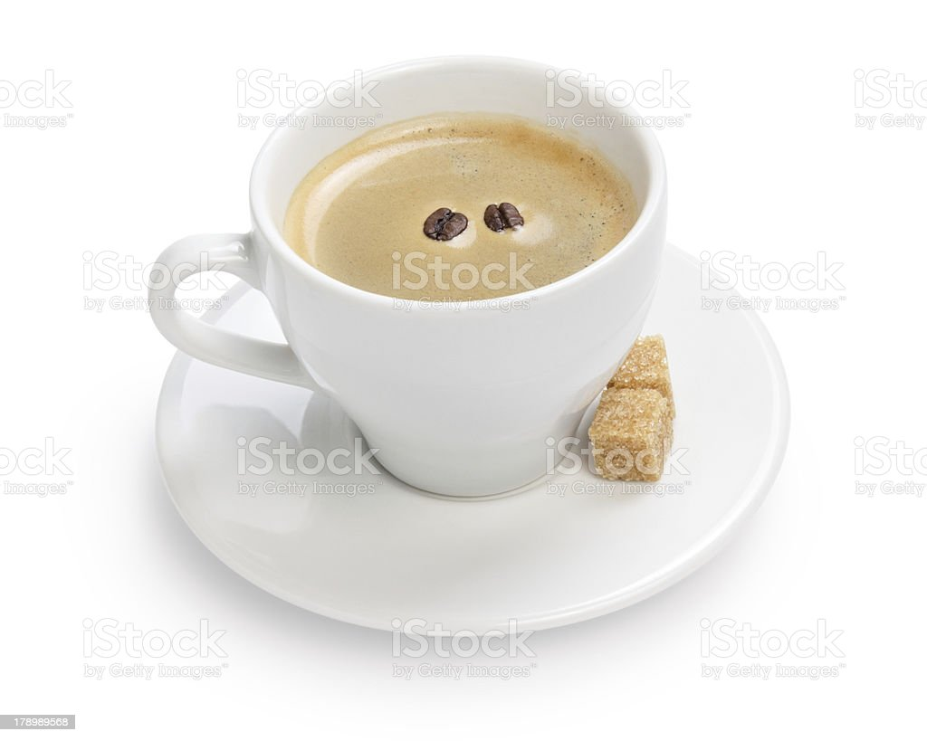 cup of espresso with cane sugar and two beans royalty-free stock photo