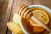 Cup of fragrant ginger tea with honey and lemon
