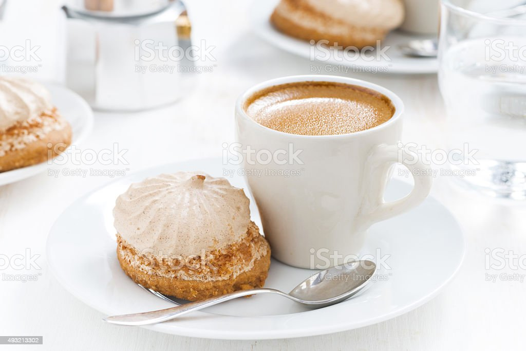 cup of fresh espresso and cakes for breakfast stock photo