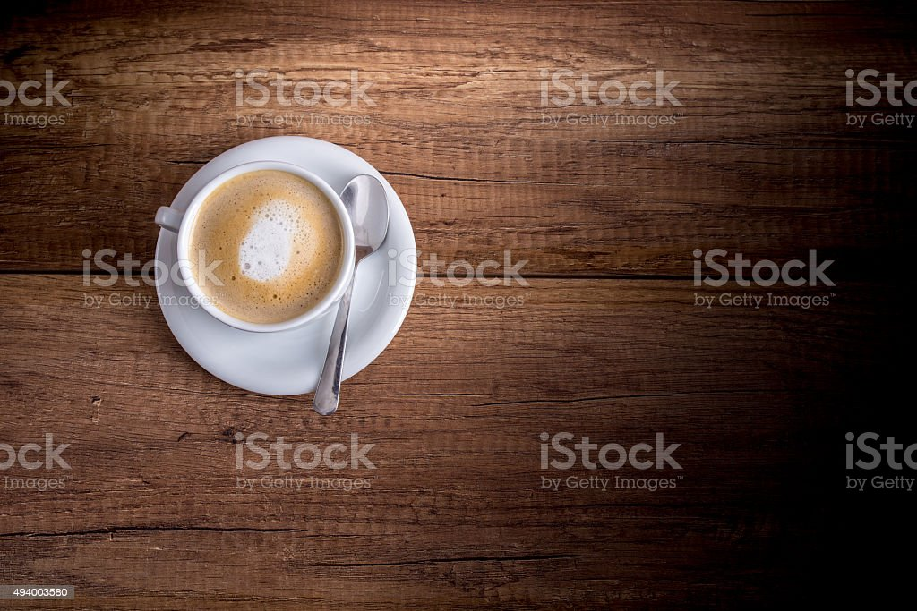 Cup of freshly brewed aromatic cappuccino stock photo