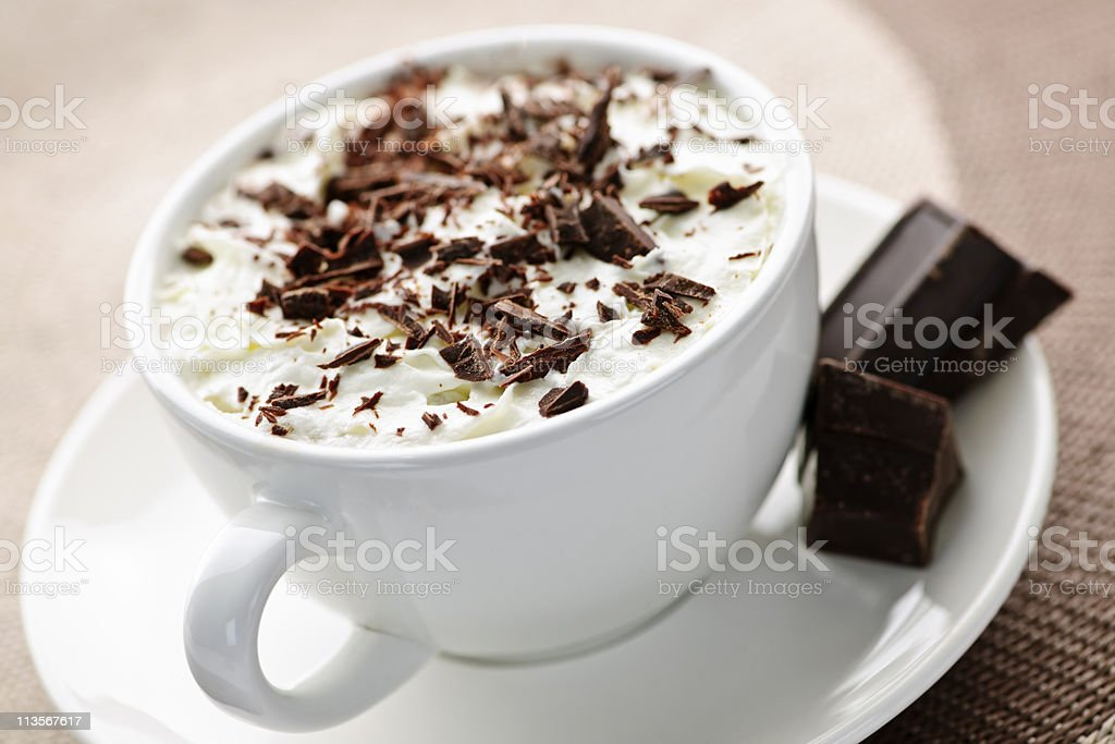 Cup of frothy hot chocolate with chocolate sprinkles royalty-free stock photo
