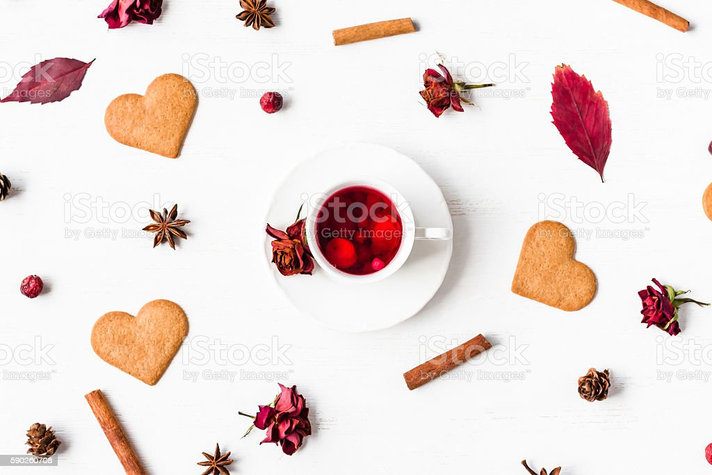 cup of fruit tea with autumn leaves, flat lay stock photo
