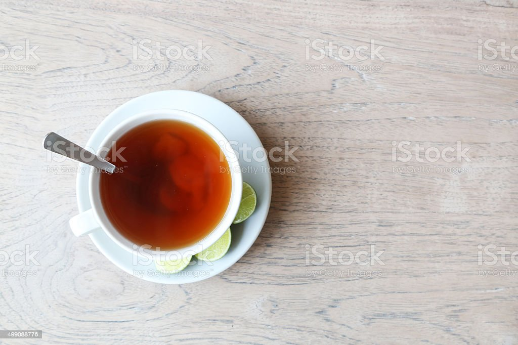 Cup of ginger lemon tea on the wooden table stock photo