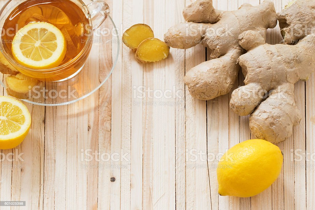 cup of ginger tea on a wooden table stock photo