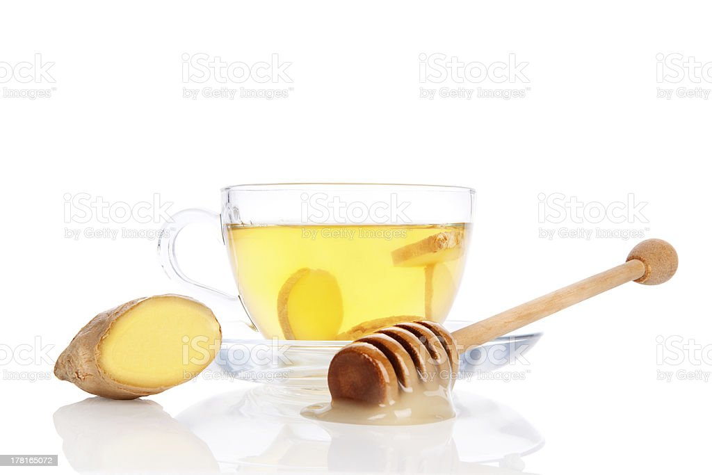 Cup of ginger tea with honey isolated. royalty-free stock photo