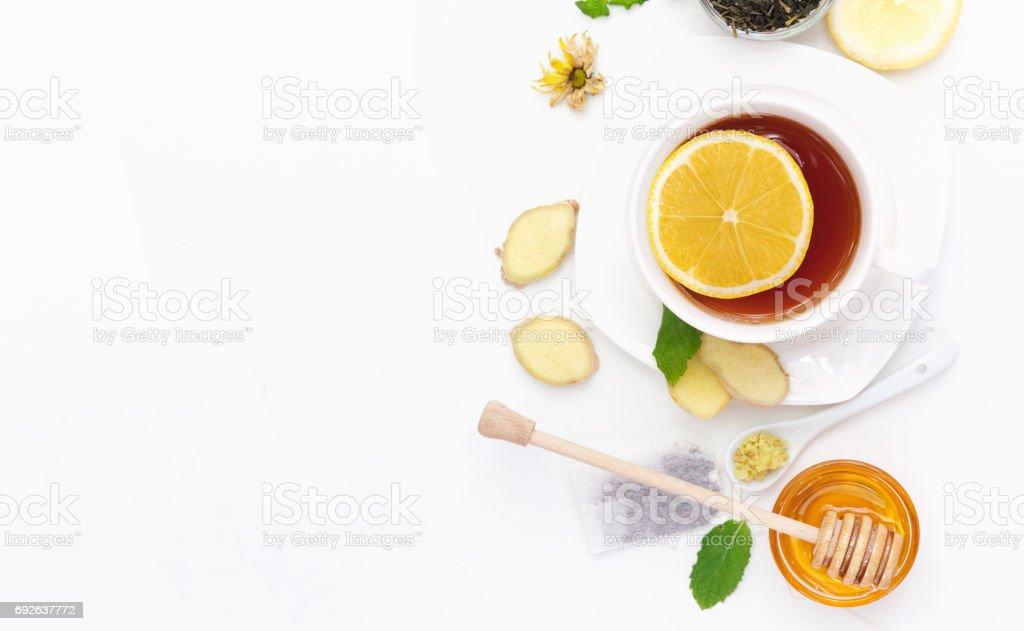Cup of ginger tea with lemon and honey. Flat lay, top view, copy space stock photo