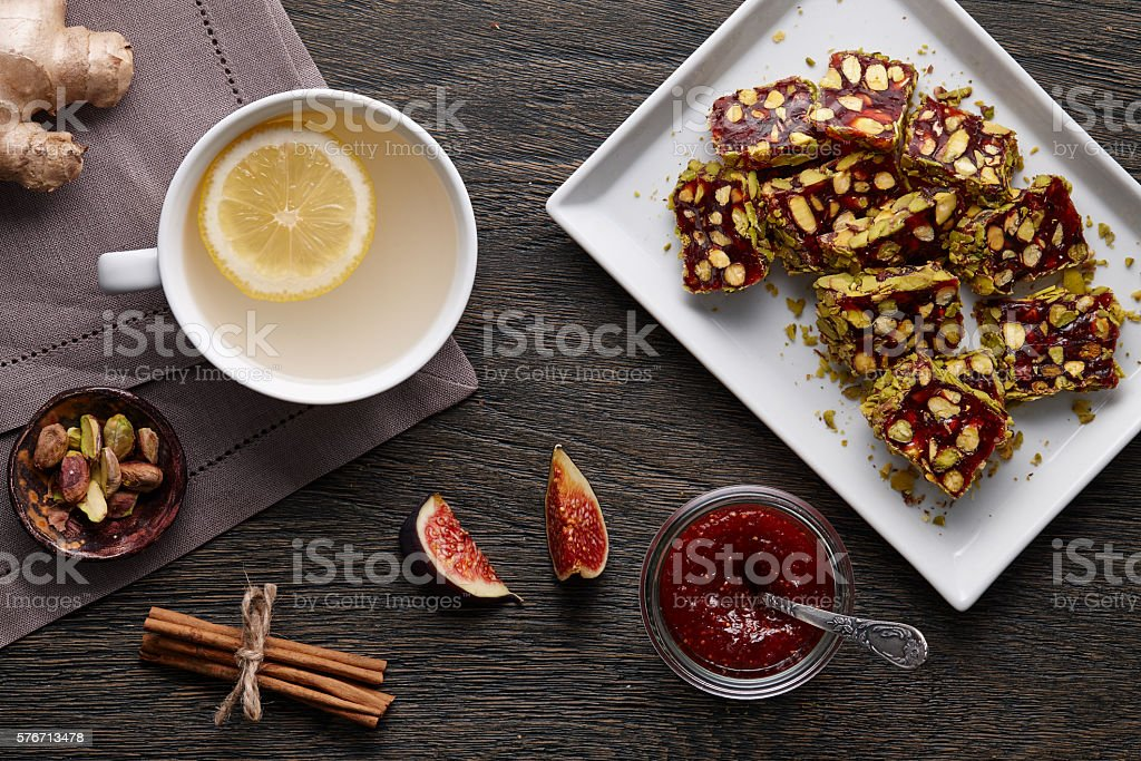 Cup of ginger tea with lemon and turkish delight stock photo