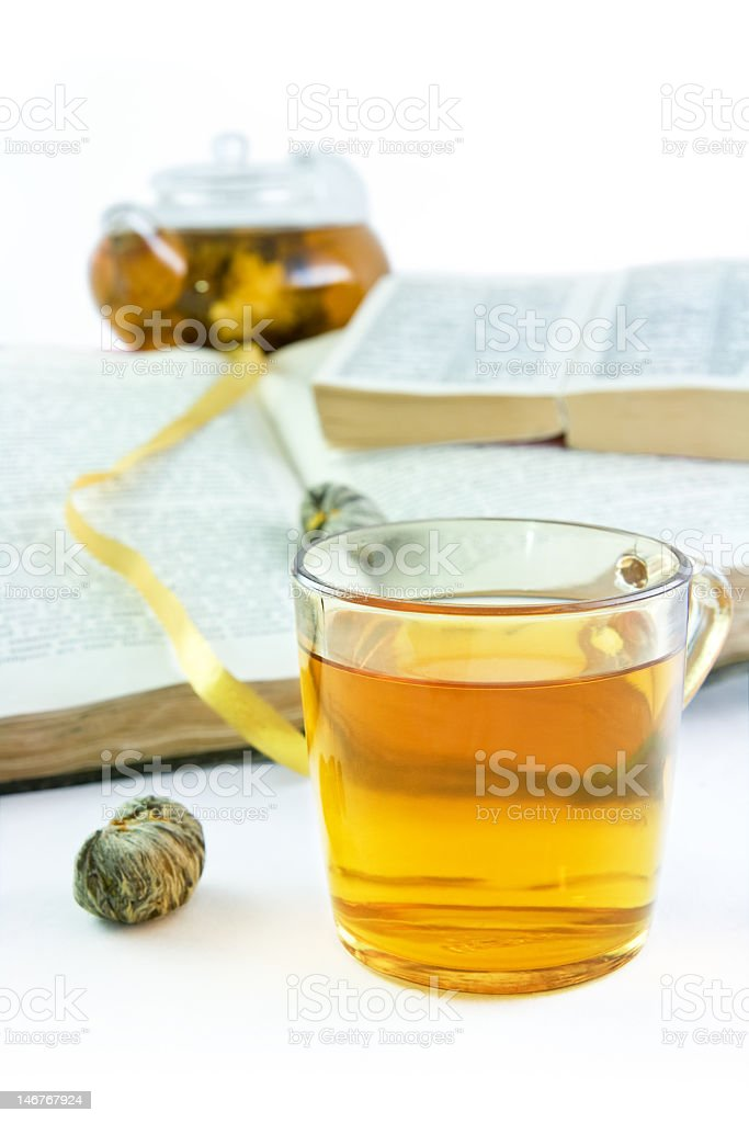 Cup of green tea against the opened books royalty-free stock photo