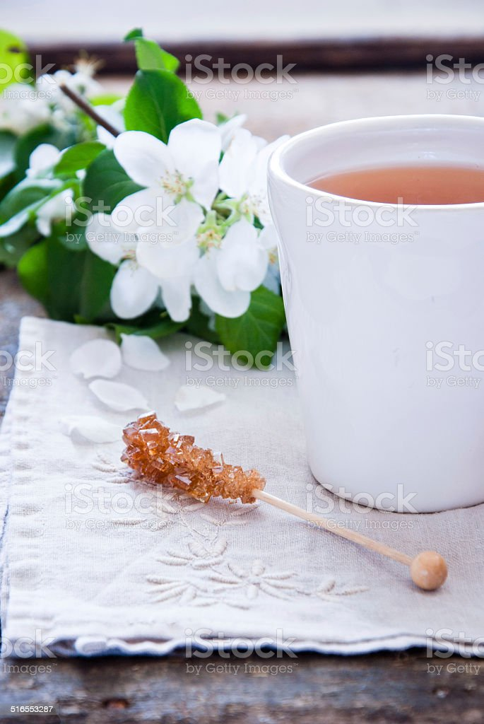 Cup of green tea and blossom stock photo