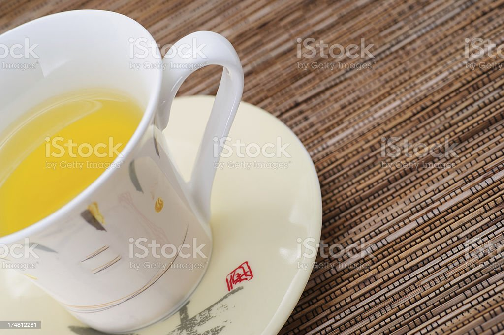 Cup of Green Tea from above on Bamboo Mat royalty-free stock photo