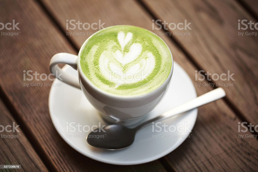Cup of green tea matcha latte stock photo