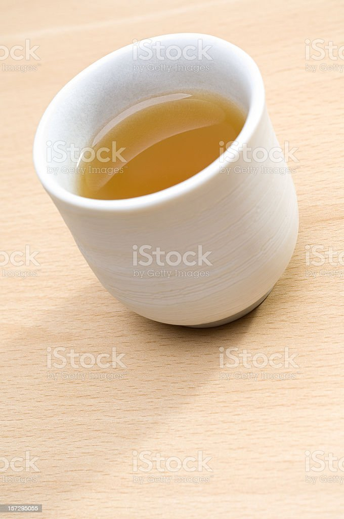Cup of green tea on wooden table royalty-free stock photo