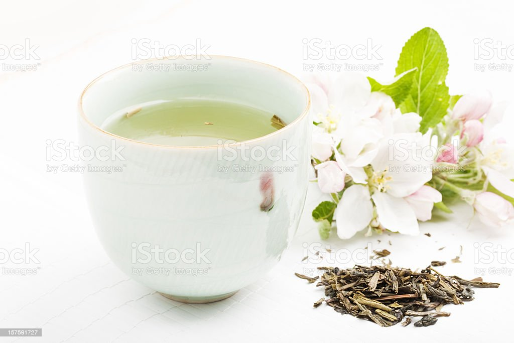 cup of green tea with blossom royalty-free stock photo