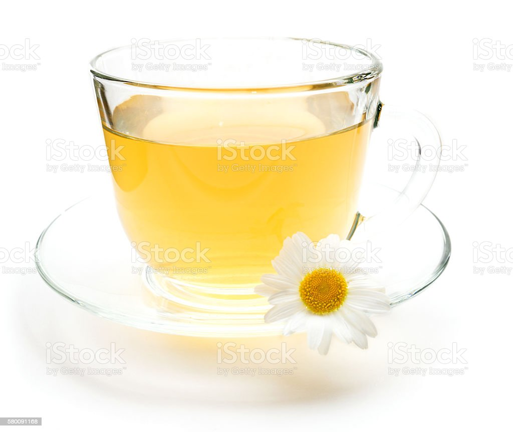 Cup of green tea with chamomile flower stock photo