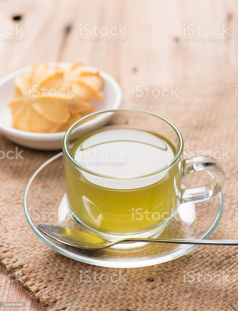 cup of green tea with cookies stock photo