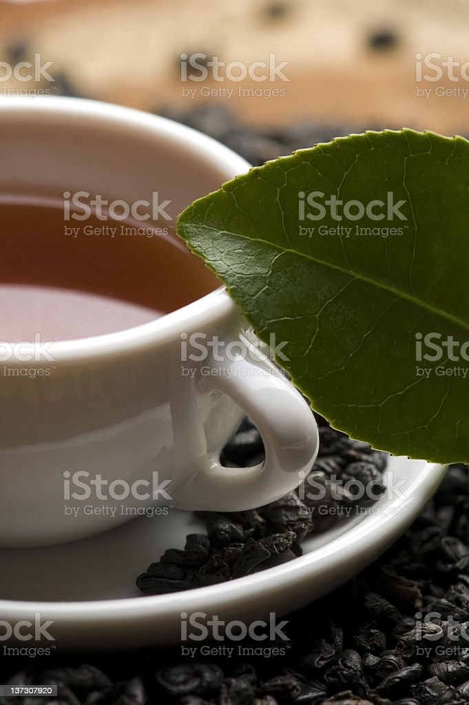 cup of green tea with freh leaves royalty-free stock photo