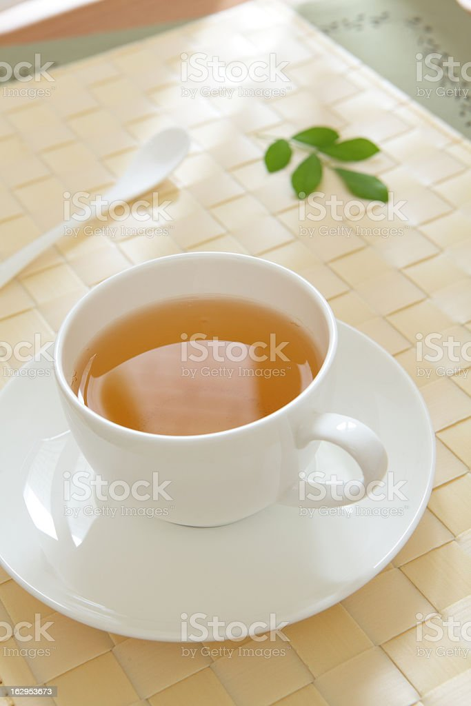 cup of green tea with morning sunlight royalty-free stock photo