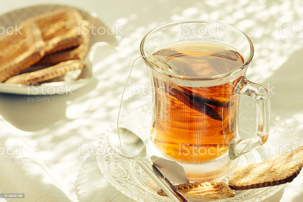Cup of Healthy Tea over breakfast table stock photo
