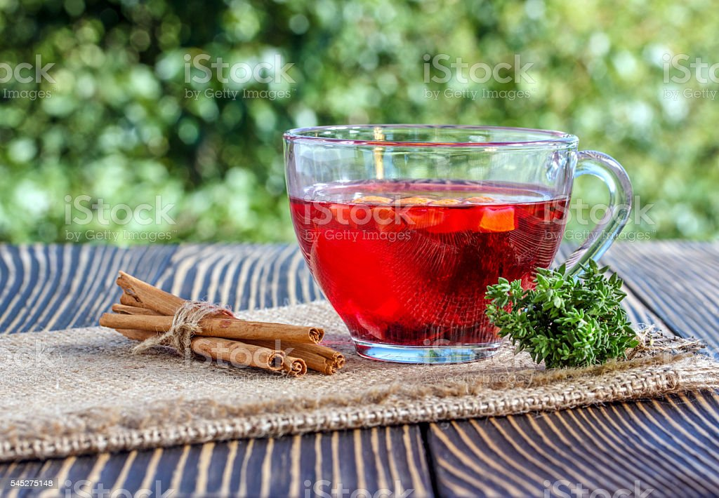 Cup of herbal tea  on a wooden table stock photo