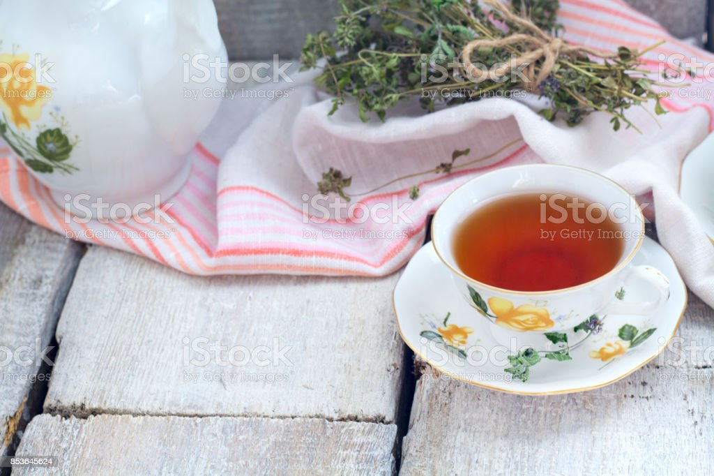 Cup of herbal tea on dark aged rustic background, place for text stock photo