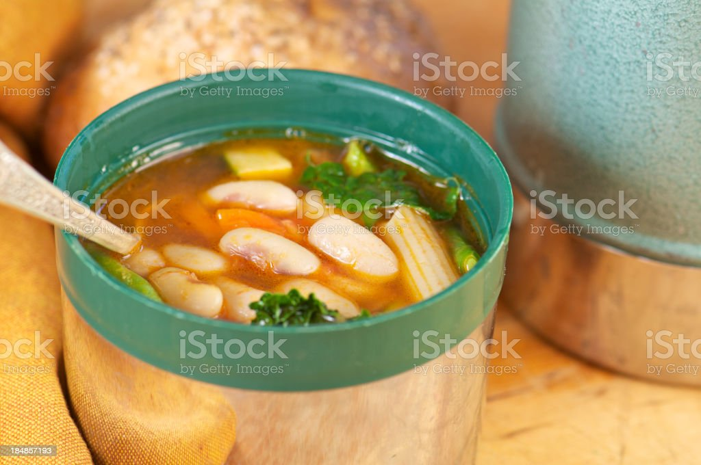 Cup of Homemade Minestrone Soup in Vintage Thermos stock photo