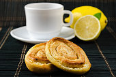 cup of hot black tea, lemon, homemade cookies