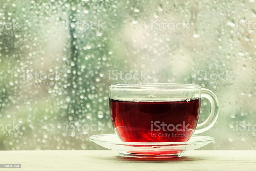 Cup of hot black tea on the blurred background stock photo